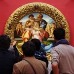 Viewers in front of Michelangelo's Doni tondo (c. 1506) Uffizi Gallery, Florence